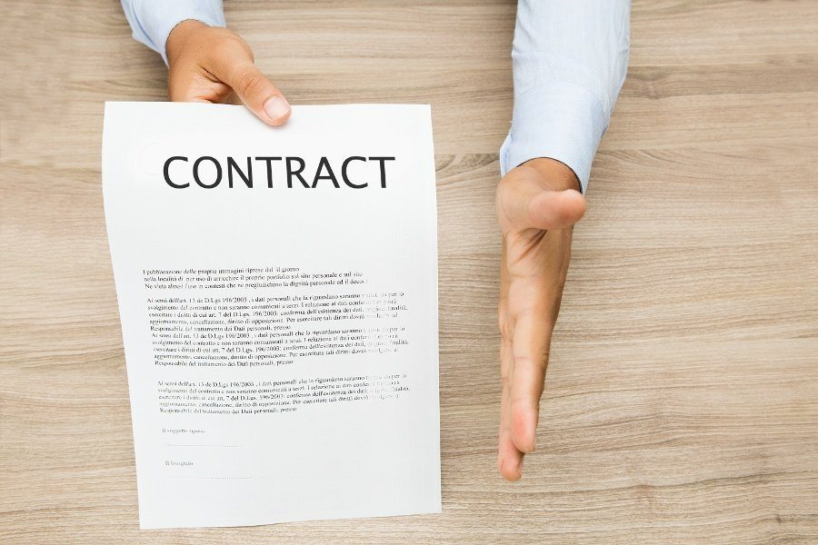contract paper and a mans hand