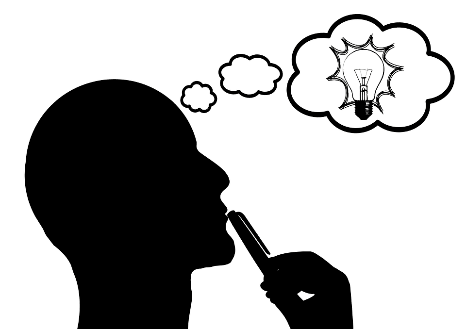 silhouette of man thinking with a thought bubble with a lightbulb inside